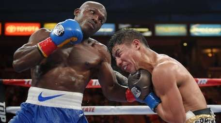 Timothy Bradley, left, connects with Jessie Vargas during