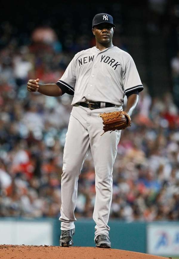 Michael Pineda #35 of the Yankees throws
