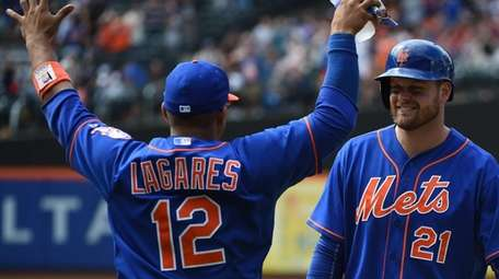 Mets centerfielder Juan Lagares celebrates with first baseman