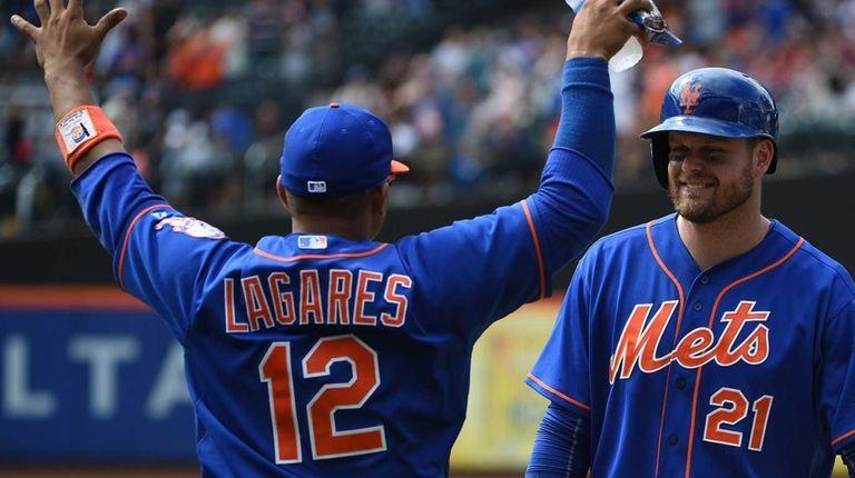 Mets centerfielder Juan Lagares celebrates with first baseman