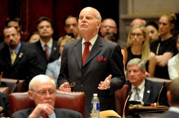 Former Sen. Stephen Saland casts his vote for