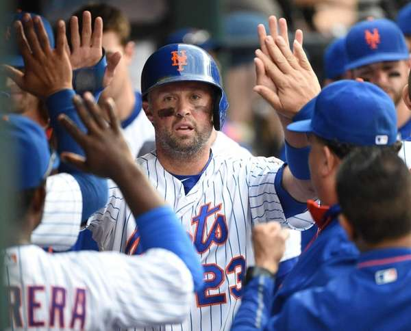 New York Mets leftfielder Michael Cuddyer is greeted