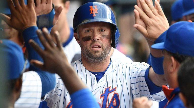 New York Mets leftfielder Michael Cuddyer is greeted