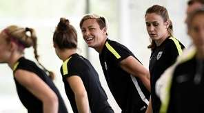 USA forward Abby Wambach, center, attends a training