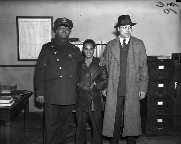 Samuel Battle, left, with Lino Rivera, center, a