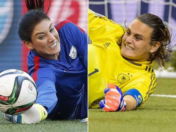 USA goalie Hope Solo, left, and Germany goalie