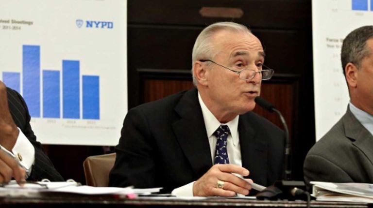 New York City Police Commissioner Bill Bratton, center,