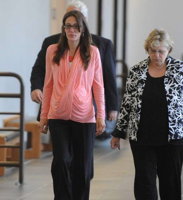 Clarissa Hertzler, left, is shown at Suffolk County