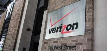 A sign hangs on the Verizon headquarters on