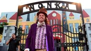 Andy Fortier dressed as Willy Wonka greets guests