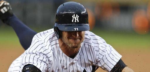 The New York Yankees' Brett Gardner (11) slides