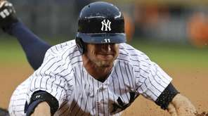 The New York Yankees' Brett Gardner (11) slides