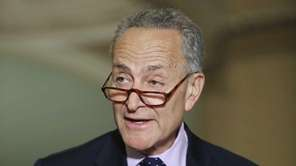 Sen. Chuck Schumer talks to reporters following the