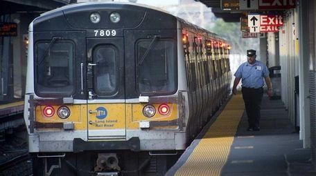 An LIRR conductor checks out his train while
