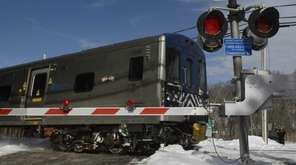 A southbound Metro-North commuter train passes the train