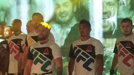 Athletes pose with new joint UFC-Reebok gear.