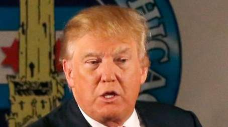 Republican presidential candidate Donald Trump casts a shadow