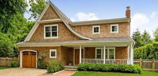 This four-bedroom, shingle-style traditional down the block from