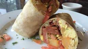Breakfast burritos with eggs, Monterey Jack cheese, salsa