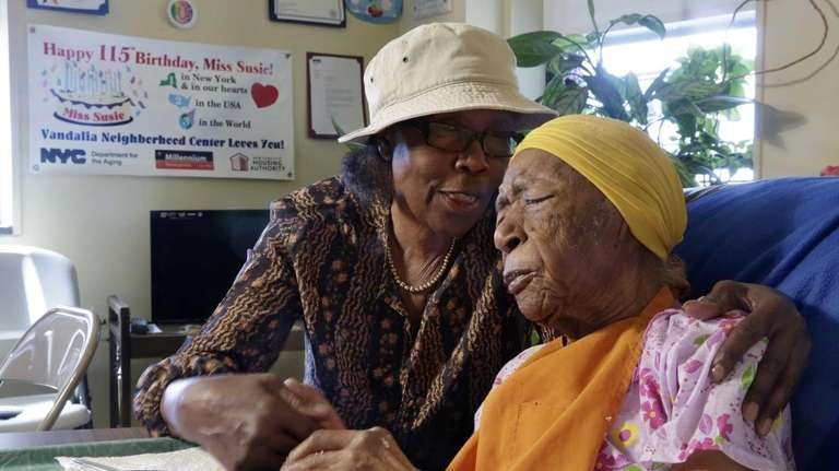 Susannah Mushatt Jones, 115, right, of Brooklyn, was