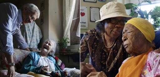 Left, Emma Morano, 115, smiles at her physician,