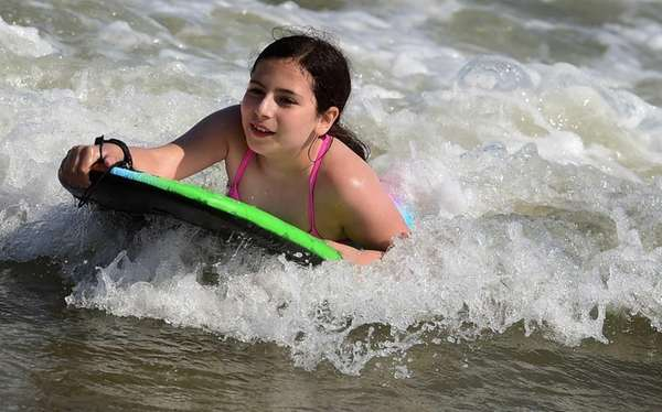 Eleven-year-old Christiana Yerinides of Connecticut enjoys the sun