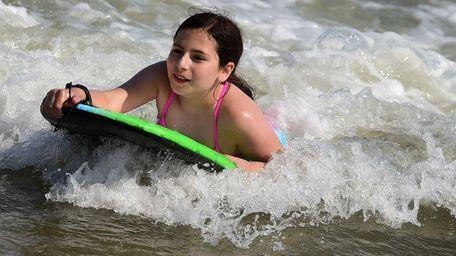 Eleven-year-old Christiana Yerinides of Connecticut enjoys the sun
