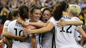 Carli Lloyd of Germany celebrates with teammates as