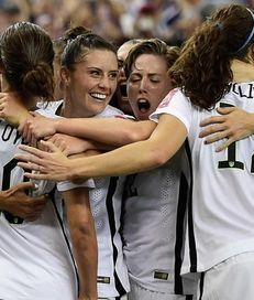 USA's Carli Lloyd, No. 10, celebrates with teammates