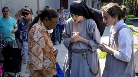People gather and pray Tuesday, June 30, 2015,