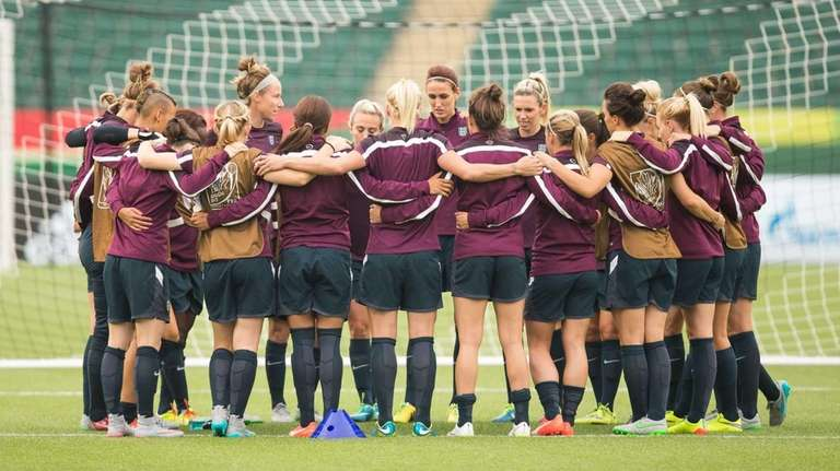England's players huddle before the start of their