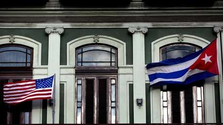 American and Cuban flags wave from the balcony