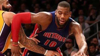 Greg Monroe of the Detroit Pistons drives against
