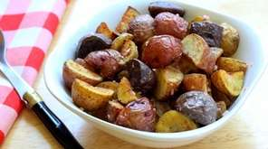 Small red, white and purple potatoes are roasted