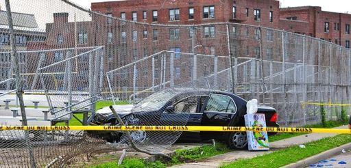 Police tape blocks off the scene of a