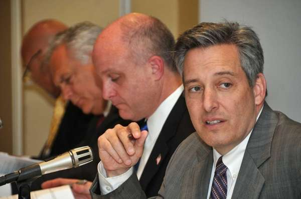 Jon Kaiman, chairman of NIFA, right, speaks during
