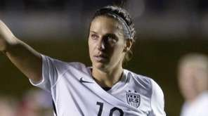 The United States' Carli Lloyd (10) looks toward
