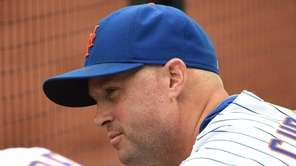 The New York Mets' Michael Cuddyer looks on