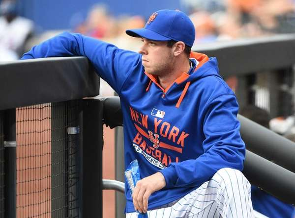 Mets pitcher Steven Matz looks on from the