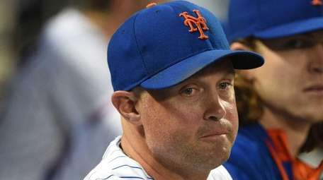 Mets leftfielder Michael Cuddyer looks on from the