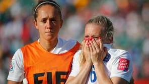 Laura Bassett of England is comforted by Jo