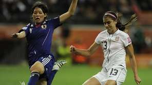 The United States' Alex Morgan scores the opening