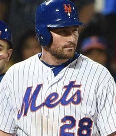 New York Mets shortstop Ruben Tejada, right, stands