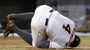 The Houston Astros' George Springer hits the ground