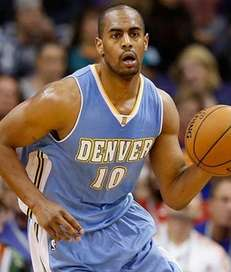 Arron Afflalo of the Denver Nuggets handles the