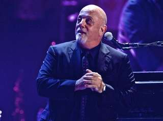 Billy Joel in concert for a record 65th
