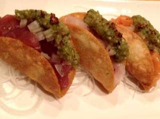 Tuna, salmon and yellowtail tacos are served at