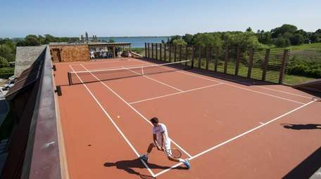 The rooftop tennis court has 180-degree views of