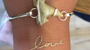 Channel your inner surfer with this shark-tooth bracelet;