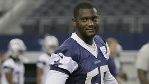 Dallas Cowboys middle linebacker Rolando McClain gestures towards